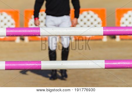 Equestrian show jumping rider unidentified walking pacing gate poles distances