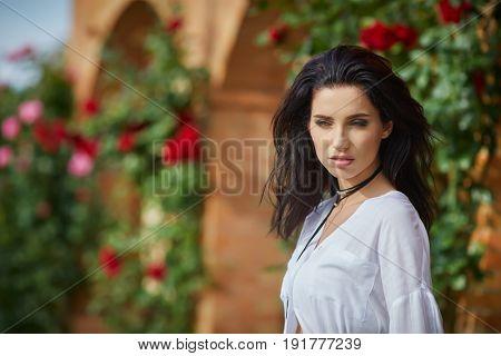 Beautiful woman resting in the summer the Italian garden
