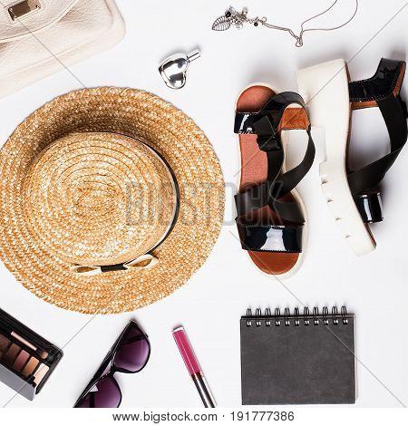 Stylish feminine accessories on white, top view