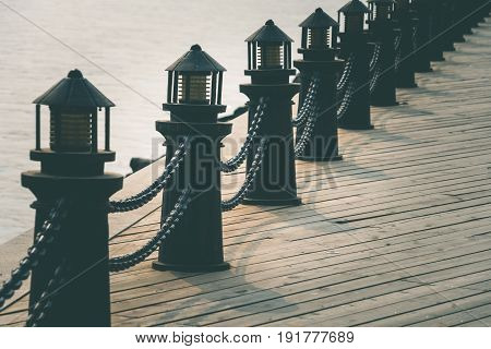 detail shot of bollards in row along riverside shot in Dalian China.