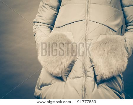 Seasonal fashion clothes and clothing concept. Woman wearing light winter warm furry coat perfect for cold days