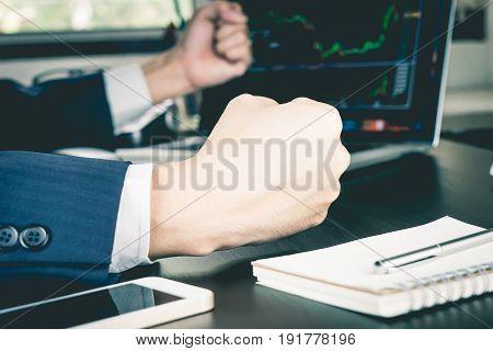 Business man fist is winning on stock market