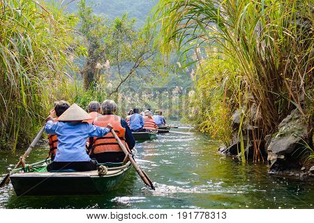 International Tourists Traveling On Local Vietnamese Small Boat