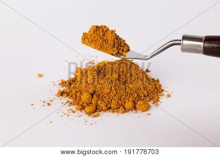 french ochre pigment on a white background