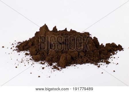 brown pigment on a white background macro