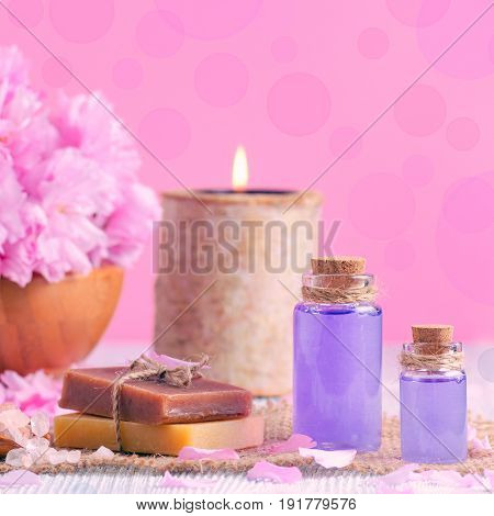 lavender oil soap salt fresh flowers candle on pink for spa and wellness bokeh toned