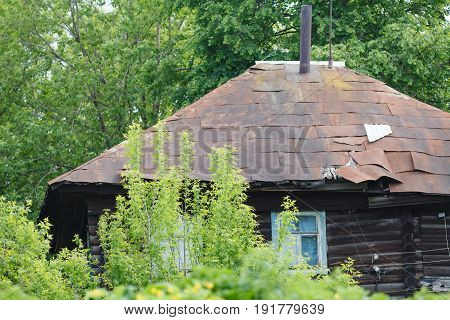 Old wooden house dwelling of beggars in tree