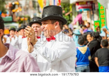 Banos De Agua Santa Ecuador - 29 November 2014: Group Of Latino People From Ecuador Dancing On The Streets Of Banos De Agua Santa South America On November 29 2014