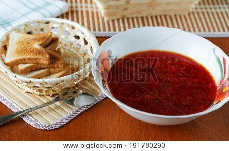 Plate Of Soup And Croutons On The Table