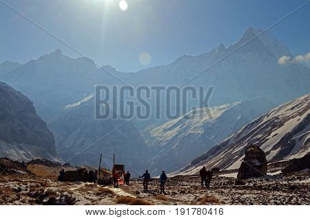 People in Annapurna Base Camp. Morning Mountain Landscape in Himalaya, Nepal.