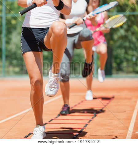Cardio tennis workout outdoors, color image, focus on legs