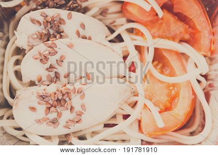 Healthy lunch in foil container. Fitness menu take away and delivery. Durum wheat pasta, steamed turkey, fresh vegetables and flax seeds in box, closeup, vintage filter