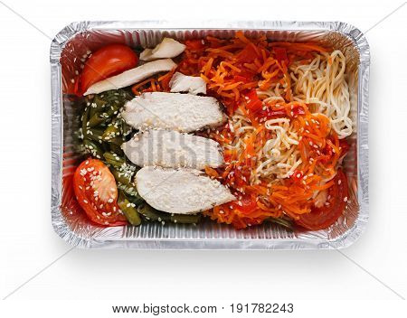 Healthy restaurant lunch. Daily take away meals. Fitness nutrition, weight loss diet. Steamed turkey with durum wheat pasta and vegetable salad in foil box. Isolated on white background, cutout