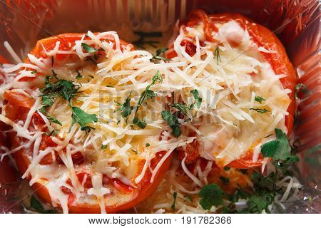 Healthy food background. Daily slimming menu. Organic restaurant food take away and delivery. Baked tomatoes with low fat cheese and greens in foil box, closeup