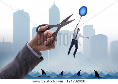 Businessman flying holding balloon