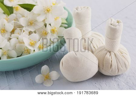 thai herbal compress massage with jasmine flowers - beauty treatment