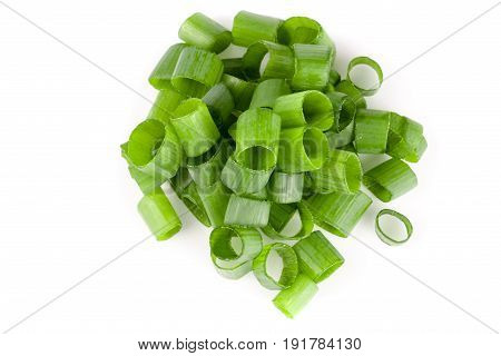 Chopped fresh spring onions isolated on white background. Top view