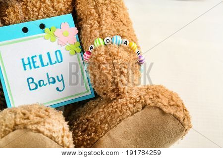 Bracelet with baby name Noah on bear's paw, close up
