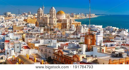 Aerial panoramic view of the old city rooftops and Cathedral de Santa Cruz in the morning from tower Tavira in Cadiz, Andalusia, Spain poster