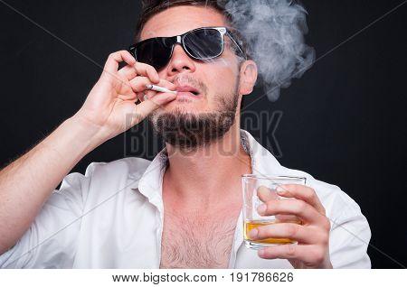 Closeu-up Portrait Of Mafia Killer Smoking Cigar