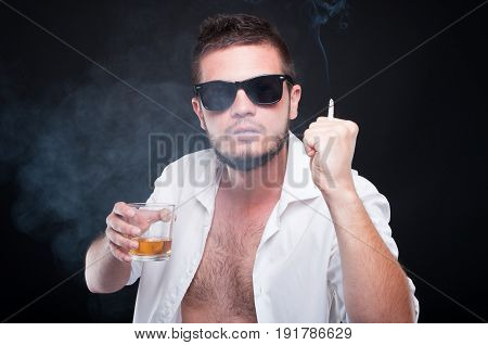 Aggressive Young Male Fighting While Drinking Whiskey
