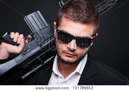 Closeup Portrait Of Male Gangster With Automatic Weapon