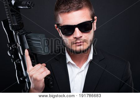 Portrati Of Attractive Man With A Shotgun