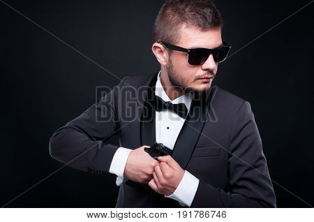 Assassin Or Gangster Taking Gun From Jacket