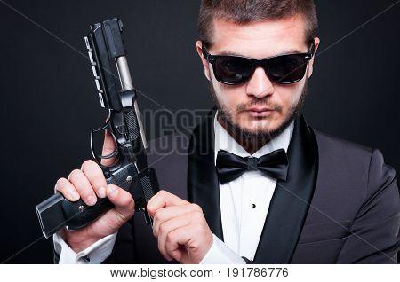 Gunman Loading The Chamber Of His Gun