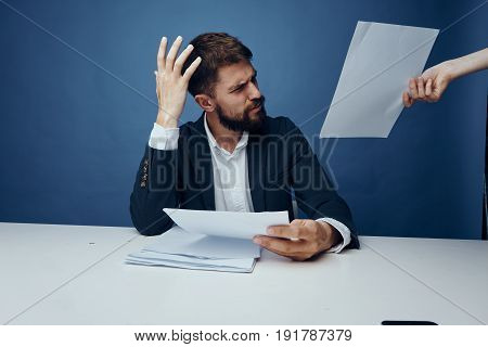 Business man looking at documents, business man unhappy, businessman on blu background.