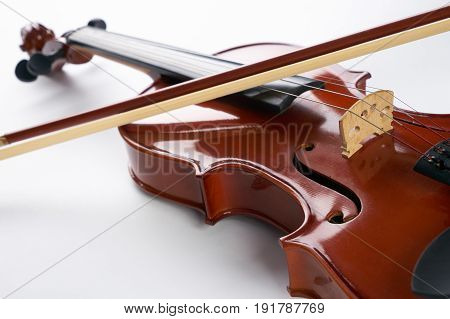 Violin with bow isolated on white background. Classical stringed musical instrument fiddle with fiddlestick.
