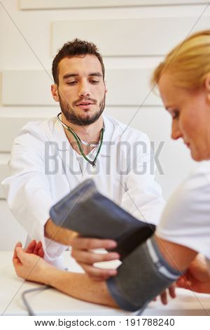 Doctor during provision examination to check hypertension