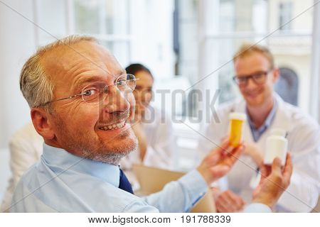 Senior citizent as patient smiling in consultation with doctor