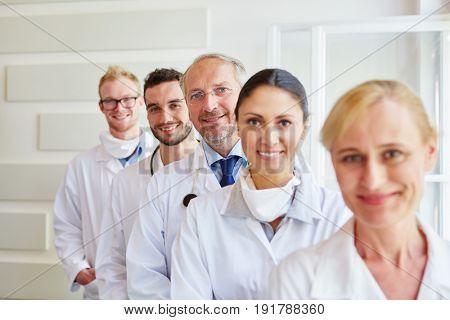 Group of medical successful team members at hospital