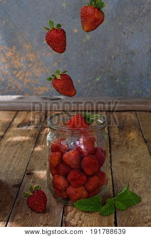 Composition Of Flying Strawberry In Jar. Cooking Preparation Compote Or Jam. Homemade Conservation W