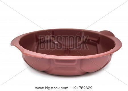 Close up round silicone baking pan isolated on white background