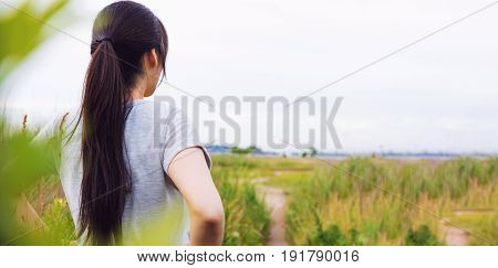 Woman Looking Out At The Path Ahead