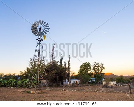 Windmill next to a farm on the road to Solitaire Khomas Highlands Namibia.