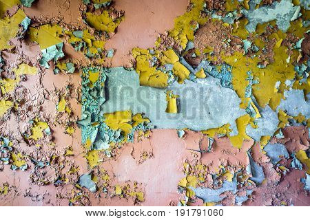 Cracking paint on a wall in building of abandoned military town called Chernobyl-2 in Chernobyl Exclusion Zone Ukraine