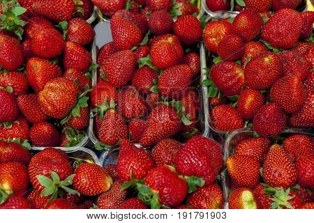 Ripe juicy strawberries closeup. Great background for a label jam, berry jam, strawberry juice, fruit wine.