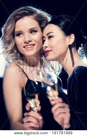 Happy Glamour Multicultural Girls Holding Champagne Glasses And Spending Time At Party