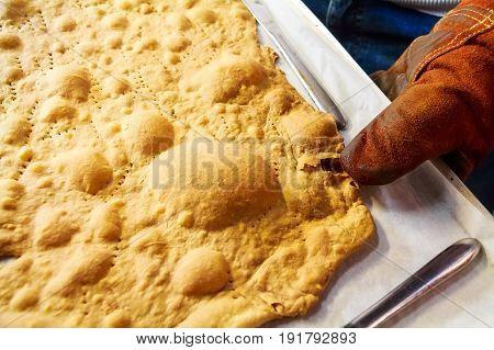 Close up freshly backed layer of Napoleon cake on tray