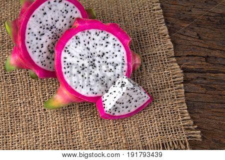 Close up sliced Fresh Dragon fruit or Pitahaya fruit on wooden background