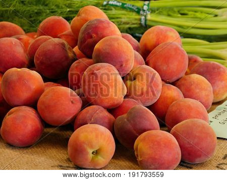 Pile of ripe peaches Pile of red ripe peaches displayed on a mat