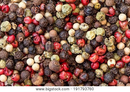 Close up mixed type of peppercorns background top view or overhead shot