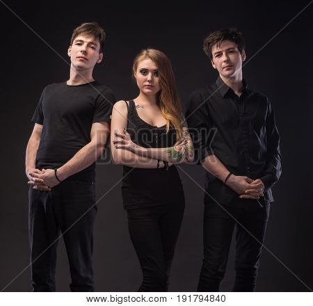 Young Woman Posing With Two Young Man
