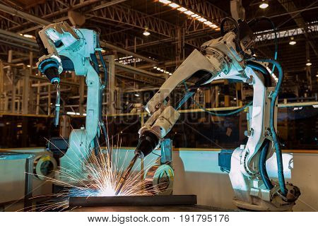 Robot is welding assembly automotive part .