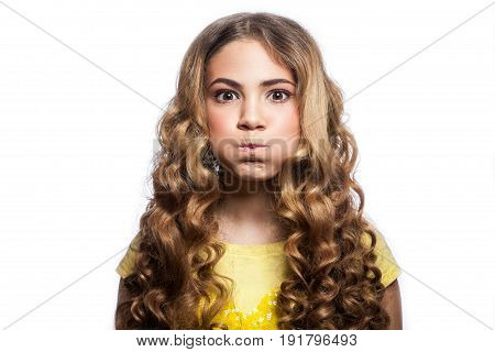 Portrait of bored girl with wavy hairstyle and yellow t shirt. studio shot isolated on white background.