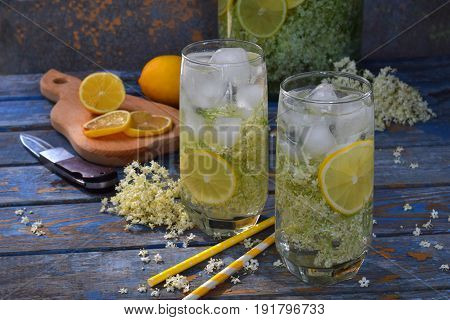 Elderberry Flowers And Lemon Drink. Refreshment Healthy Elder Juice. Glass Of Elderflower Lemonade O