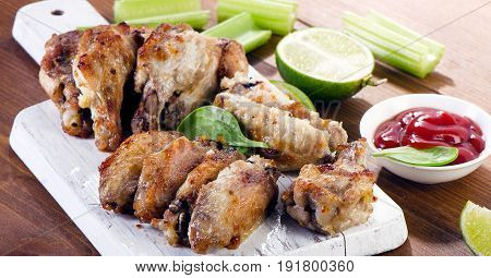 Chicken Wings With Celery On A Wooden Cutting Board